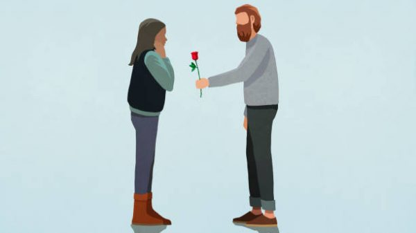 Man giving rose to surprised girlfriend